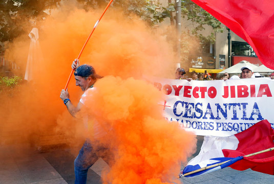 Chilean Industrial fishermen take part in a protest to demand modification of a fishing law for the extraction of squids, in Santiago