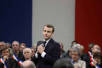 French President Emmanuel Macron speaks during a meeting attended by some 600 mayors of Occitania to relay their constituent's grievances in Souillac