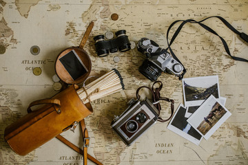 vintage map, antique film cameras, binoculars and matches