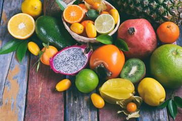 Mix of ripe tropical fruits with avocado, mango, coconut, carambola, banana, kumquat, pitahaya, kiwi Superfood background Vegetarian food
