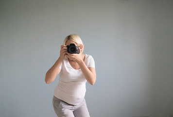 pregnant woman photographer with a film camera