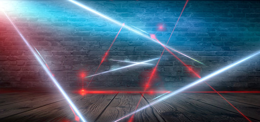 Dark room, street, tunnel, corridor, background with searchlight rays and a red laser beam, smoke, smog, dust. Abstract dark blue background with neon and rays.