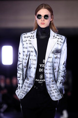 A model presents a creation by designer Olivier Rousteing as part of his Fall/Winter 2019-2020 collection show for fashion house Balmain during Men's Fashion Week in Paris