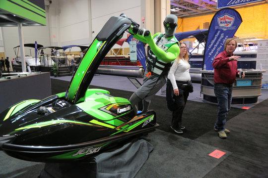 Guests view a Kawasaki jet ski on display at the Toronto Boat Show