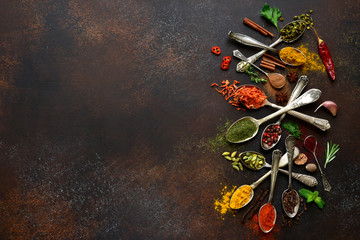 Assortment of natural spices on a vintage spoons.Top view with copy space.