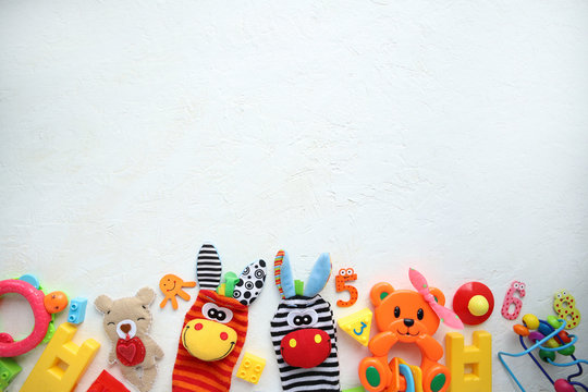 Children's toys and accessories on a white background. View from above
