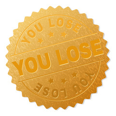 YOU LOSE gold stamp award. Vector gold award with YOU LOSE tag. Text labels are placed between parallel lines and on circle. Golden surface has metallic texture.