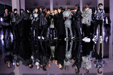 Designer Olivier Rousteing reacts with models at the end of his Fall/Winter 2019-2020 collection show for fashion house Balmain during Men's Fashion Week in Paris