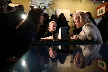 U.S. Senator Kirsten Gillibrand (D-NY) talks to customers Jeanette Hopkins and Chloe McClure, 15, both of Sioux City, at the Pierce Street Coffee Works while on a walking tour after announcing that she is forming an exploratory committee to enter the 2020