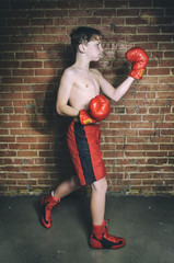 Male Youth Boxer Training Before a Fight