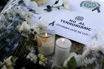 """A sign that reads """"No to terrorism, Colombia is in mourning"""" is seen in front of the scene where a car bomb exploded, in Bogota"""
