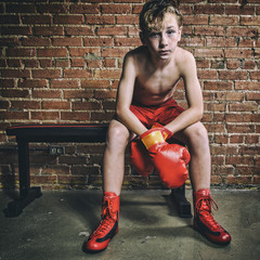 Sweaty Male Youth Boxer Resting After a Grueling Match