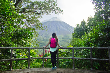 Female hiker looking out at the Arenal volcano in Costa Rica