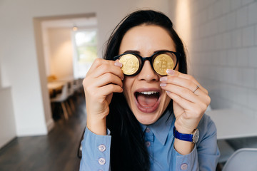 successful funny girl freelancer keeps golden bitcoins