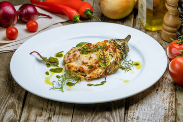 baked eggplant on plate with parmesan