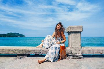 cheerful stylish young woman having fun outdoors