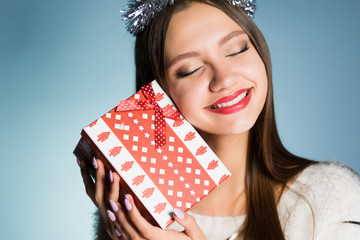 young happy girl received a gift for the new year 2018 about colleagues at work