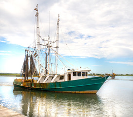 Nautical shrimp fishing boat Gulf of Mexico harbor sailing for marine life in sea