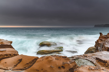 Turbulent Dawn Seascape from Sandstone Headland