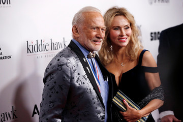Buzz Aldrin and guest pose as they arrive at the 16th Annual Living Legends of Aviation Awards in Beverly Hills