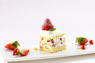 Delicate strawberry cake on white background