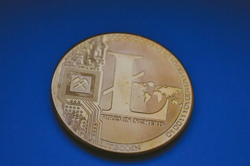 Crypto currency coins on blue background