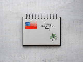St.Patrick's Day. Beautiful card. Notebook with congratulatory inscription