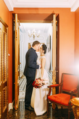 Meeting the newlyweds in the Studio and hotel. Bride and groom with a bouquet.
