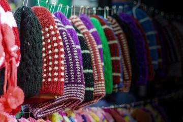 colourful woolen caps for sale at a garment shop. Winter shopping season