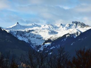 Winter and snow on the Alpine peaks in the mountain range Glarus Alps - Canton of St. Gallen, Switzerland