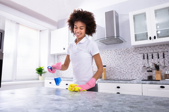 African Woman Cleaning Kitchen Counter