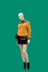 Full-length female mannequins.