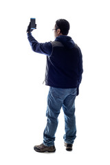 Male hiker or tourist doing mobile photography with a cell phone camera.  Isolated on a white background for composites or copyspace.