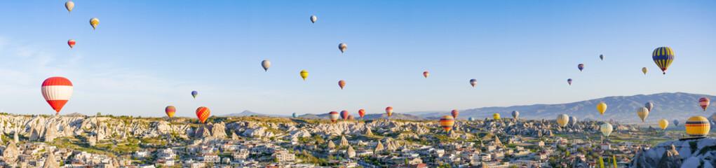 Tuinposter Ballon Colorful hot air balloons flying over rock landscape at Cappadocia Turkey