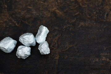 lump of silver or platinum on dark wood background