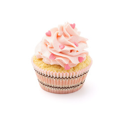 Pink cupcake with candy for Valentine's Day. Isolated.