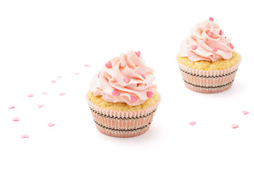 Pink cupcakes with candy for Valentine's Day. Isolated.