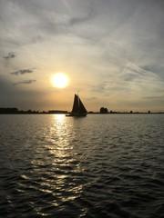 Ancient sailboat at sunset