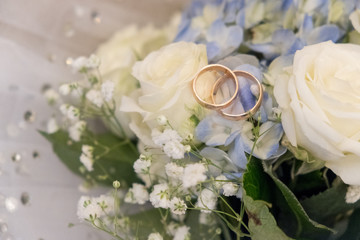 Bridal bouquet and wedding rings.