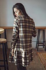 Portrait of a sexual young woman wearing checkered dress. Beautiful smart girl. Beauty, fashion of women wear showroom