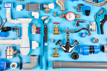 plumbing tools and equipment on blue background top view.