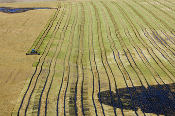 Farm tractor works a wet field in southern Manitoba.