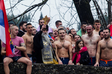 Metropolitan Amfilohije poses for a picture with believers during Epiphany Day celebrations in Podgorica
