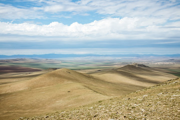 Mongolian landscape with blue sky and clouds