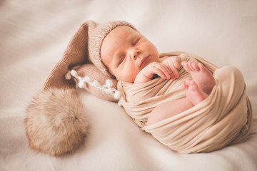Newborn baby boy in a cap with a bubo