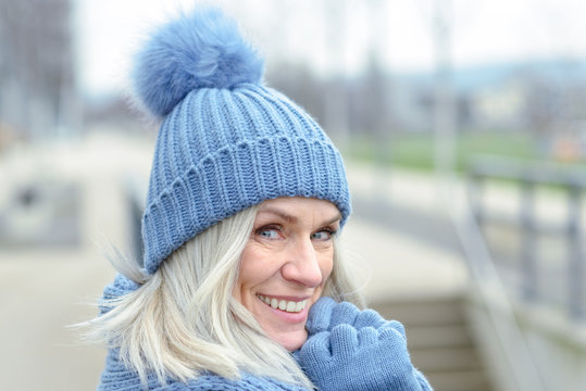 Attractive blond woman in warm winter fashion