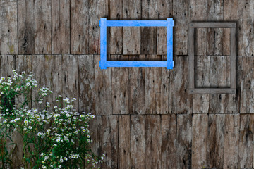 Old photo frames on wood wall. Wooden picture frame.