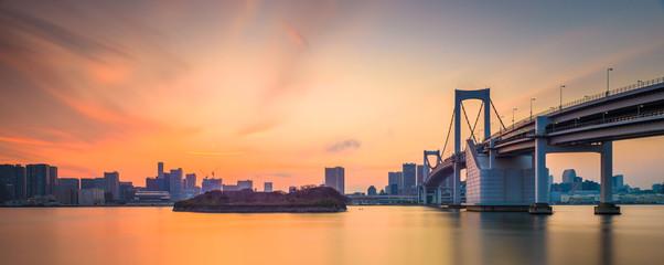 Tokyo, Japan at Rainbow Bridge spanning the bay