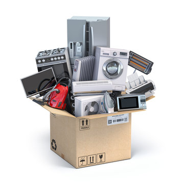 Household  kitchen appliances in open cardboard box. Delivery,  moving and online shopping concept.
