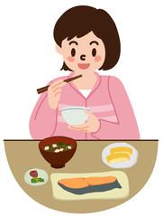 和風の食事をする女の子